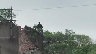 Man on top of roof