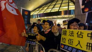 Pro-Beijing protesters shout slogans on the sidelines of a pro-democracy rally in Hong Kong on December 11, 2016