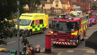 Emergency services including several fire engines and an ambulance at the scene where two of the boys were pulled free from the sewage system