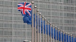 Union Jack and row of EU flags