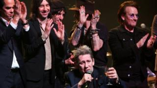 Shane is joined on stage by Bono and other musicians