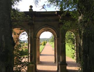 Gardens framed by archways