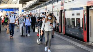Passengers wear protective masks as they leave a train of Swiss railway operator SBB, as the coronavirus disease (COVID-19) outbreak continues, at the Hauptbahnhof central station in Zurich, Switzerland July 6, 2020.