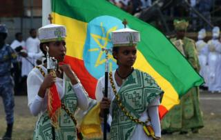 Ethiopian Christian believers, wearing traditional clothes, celebrate the Meskel Festival, commemorating the discovery of the True Cross by the Roman Empress Helena (Saint Helena) in the fourth century in Addis Ababa, Ethiopia on September 26, 2018. Thousands of Christian Orthodoxes gathered with their traditional white clothes.