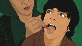 Child receiving polio drops