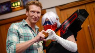 James Roberts and fan dressed as Rewind at TFNation 2017