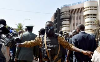 burkina security man in front of hotel