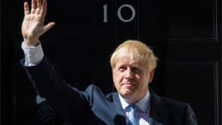 File photo dated 24/07/19 of new Prime Minister Boris Johnson waving outside 10 Downing Street,