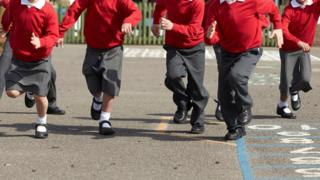 File picture of young children running through their school playground.
