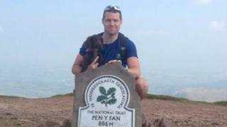 Detective Inspector Terry Hopkins on top of Pen Y Fan