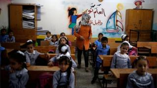 Palestinian schoolchildren sit inside a classroom at an Unrwa-run school on the first day of a new school year in Gaza City on 29 August 2018
