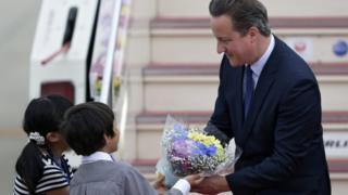 David Cameron receives flowers from Japanese school children upon his arrival at Chubu Centrair International Airport in Tokoname, Aichi Prefecture, central Japan, 25 May 2016