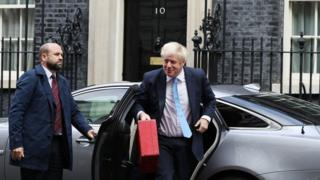 Boris Johnson getting out of a car outside 10 Downing Street