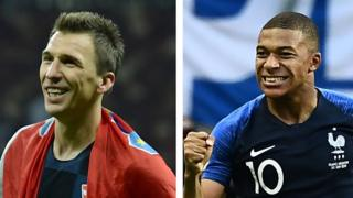 Mario Mandzukic and Kylian Mbappe celebrate