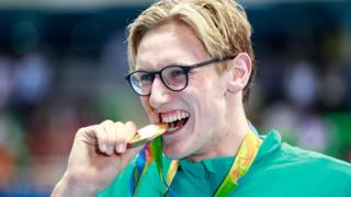 Australian swimmer Mack Horton shows off his Olympic gold medal