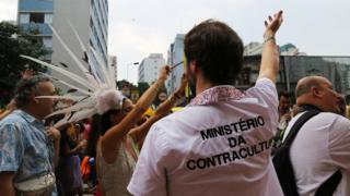 "A man wears a T-shirt emblazoned with a fake government department, the ""Ministry of Counterculture"""
