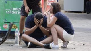 people react after a van crashed into pedestrians in Las Ramblas, Barcelona, 17 August 2017