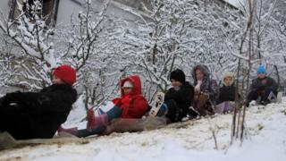 Children sliding down a snow-covered slop in Medea, Algeria - Wednesday 18 January 2017