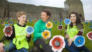 Fundraising manager Laura Parry at Rhuddlan Castle with Ysgol Eirias pupils Ethan Hughes and Amber Lea Powell