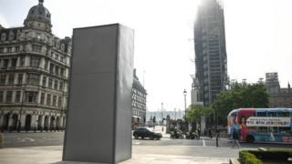 Boarded up statue of Winston Churchill