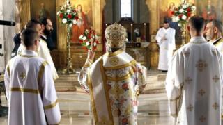The head of the Bosnian Serb Orthodox Church in Bosnia and Herzegovina conducts an Easter service