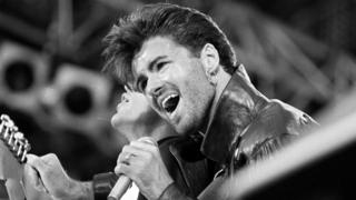 "File photo dated 28/06/86 of George Michael on stage for Wham""s last sell out concert at Wembley Stadium in London"