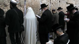 Orthodox Jews gather at the Western Wall in the Old City of Jerusalem on 28 December 2017, to pray for rain.