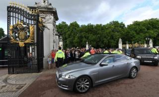 Theresa May arrives at Buckingham Palace to meet Queen Elizabeth II