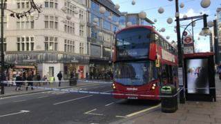 bus inside police cordon on Oxford Street
