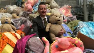 Newcastle City Council cabinet member for regulation Nick Kemp with a haul of fake goods