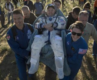 Scott Tingle is carried from the capsule. 3 June 2018
