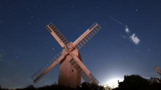 A meteor captured above the Jill Windmill in West Sussex early on Sunday