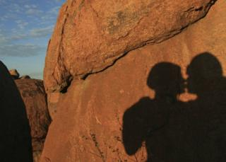 A shadow of people kissing in Namibia