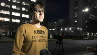 Scott McIntyre speaks outside court