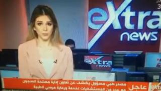Screen grab of female news presenter announcing Mohammed Morsi's death