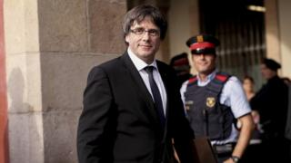 Catalan regional government president Carles Puigdemont arrives to address the Catalan regional parliament in Barcelona on October 10, 2017.
