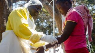 A nurse takes care of cholera patients during a visit of Zimbabwe's Health Minister,