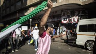 One man hold Nigeria flag for Johannesburg for 2015 as Nigerians protest attacks against dia people for South Africa