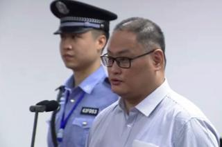 Screengrab of Lee Ming-che's trial in Hunan province