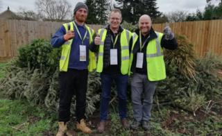 Volunteers with Christmas trees