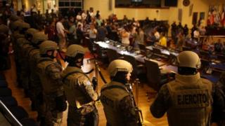 Armed soldiers stand inside parliament in El Salvador's capital San Salvador. Photo: 9 February 2020