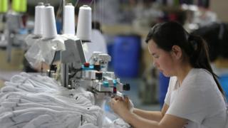 Chinese factory worker uses machine