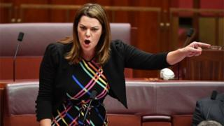 Sarah Hanson-Young speaks in the Senate, with her finger pointing sharply across the chamber
