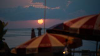 The sun sets over Patong beach in Thailand's Phuket province