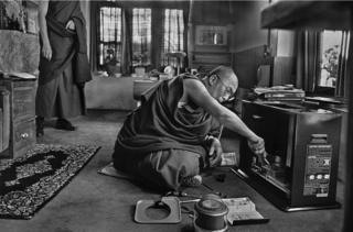 The Dalai Lama repairing the television