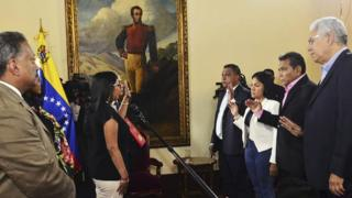 Venezuelan Constituent Assembly President Delcy Rodriguez (left) swears in four opposition governors in Caracas, 23 October 2017
