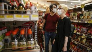 Customers wearing masks in London shops