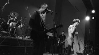 The punk band Camera Silens on stage in 1984 (the singer Gilles Bertin on the right of the photo)