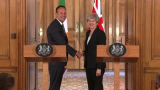 Varadkar and May shaking hands