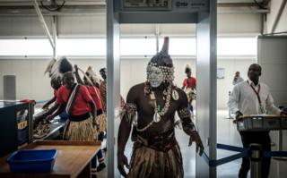 A dancer passes through a security checkpoint at the Jomo Kenyatta International airport on February 26, 2018 in Nairobi, prior to the arrival of the FIFA World Cup Trophy during its World Tou